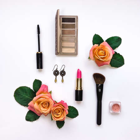 Flat lay composition with make up and essential accessories for woman. Top view, view from above on white background
