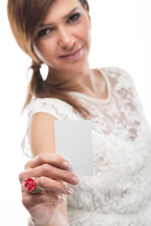 Close up of an attractive woman's hand holding a small card. Shallow depth of field, where the woman is out of focus deliberately. Stock Photo - 19533905
