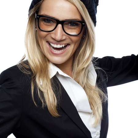 vivacious: Vivacious beautiful blond woman wearing glasses and a stylish ensemble looking at the camera isolated on white