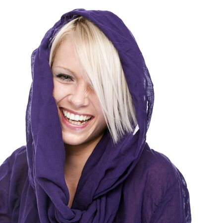 hilarity: Vivacious beautiful blond woman wearing a hooded purple top laughing at the camera, head and shoulders portrait on white Stock Photo