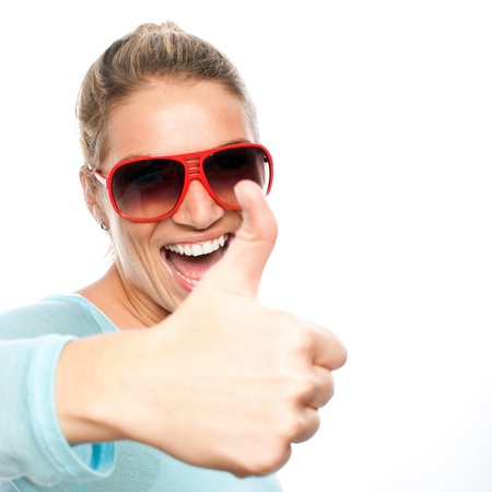 Happy excited woman showing her thumbs up in a close up portrait photo