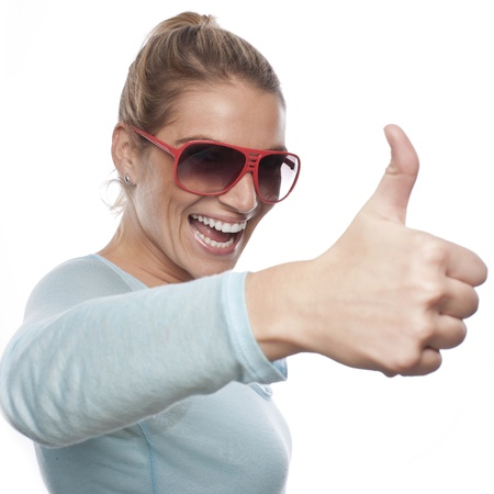 exuberant: Close up portrait of successful woman showing thumbs up Stock Photo