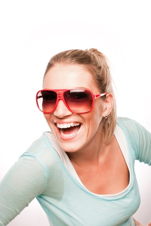 merriment: Happy beautiful woman with shades posing over the white background Stock Photo