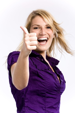 Cheerful beautiful blond woman showing an open smile and a thumbs-up wearing a purple shirt on a white background photo