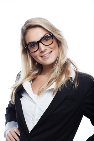 Pretty blond businesswoman wearing heavy framed glasses and standing with her hands on her hips isolated on white photo