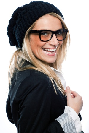 vivacious: Beautiful vivacious blond woman in a black beret and heavy framed glasses laughing at the camera isolated on white