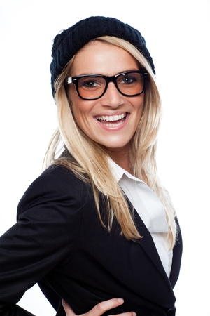vivacious: Beautiful woman with a vivacious smile wearing heavy rimmed glasses and a black beret laughing at the camera isolated on white Stock Photo