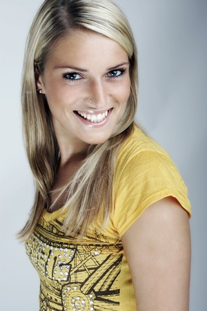 Beauty portrait of a young attractive blond woman with a joyful smile photo