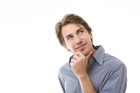 sympathetic: Sympathetic thoughtful man standing with his hand to his chin staring thoughtfully upwards isolated on white Stock Photo