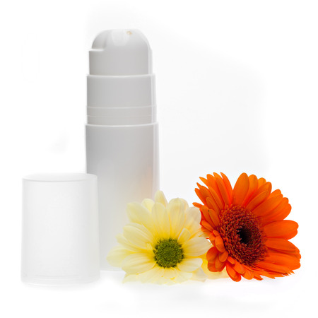 White deodorant bottle and gerbera flowers isolated on a white background photo