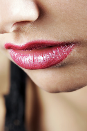 tantalising: Close up portrait of the mouth of a young woman with sexy red pouting lips Stock Photo