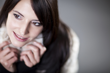 wistful: Beautiful nostalgic wistful woman staring off frame with a gentle smile, shallow dof and copyspace