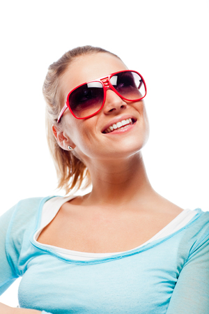 head tilted: Beautiful cool blond woman in trendy sunglasses sitting with her head tilted back and a smile of pleasure isolated on white