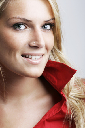 sincere: Close up portrait of the face of a beautiful fashionable young blond woman with a lovely smile
