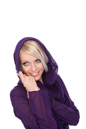 hooded top: Beautiful young blond woman with a friendly smile cuddling into a in a warm winter top with a hood, isolated on white with copyspace