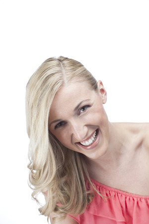 mirth: Happy vivacious laughing woman with long blond hair in a stylish off the shoulder summer dress, head and shoulders portrait isolated on white with copyspace