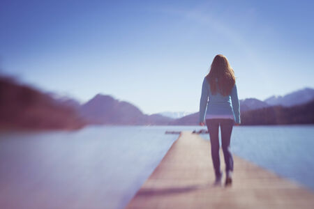 lakes: Young Lady Walking Away on Small Lake Wooden Space Path