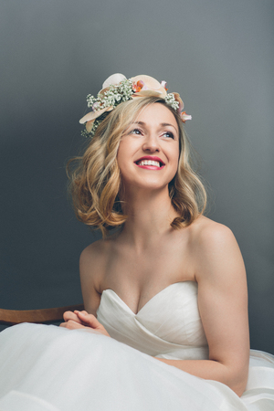 elated: Close up portrait of a pretty blond bride smiling with happiness