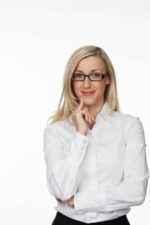 half body: Half Body Shot of an Optimistic Young Businesswoman with Eyeglasses, Smiling at the Camera with Hand on her Face. Isolated on White Background. Stock Photo