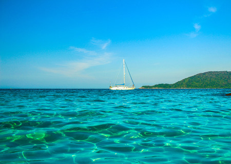 perhentian: A white yacht sailing in an ocean. Stock Photo
