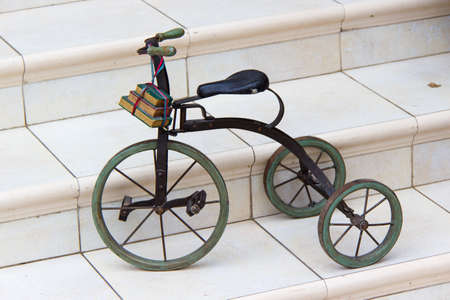 tricycle: Vintage toy tricycle Stock Photo