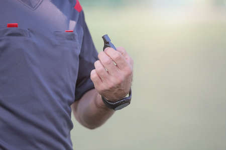 Sports referee with a whistle. Football referee.