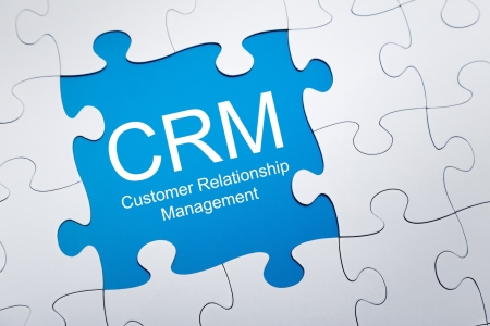 Customer relationship management on puzzle 스톡 콘텐츠