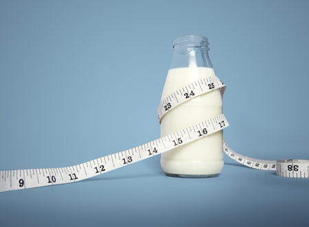 Milk bottle with Waist tape measure Reklamní fotografie