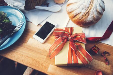 festive food: Gift box on table Stock Photo