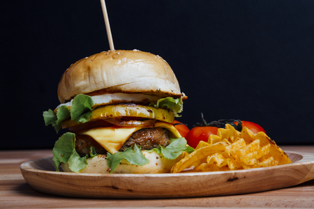 copyspace: Hamburger on black background with copyspace Stock Photo