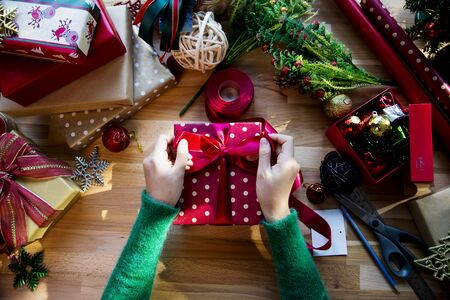 gift wrapping: Overhead shot of Christmas presents and wrapping papers Stock Photo