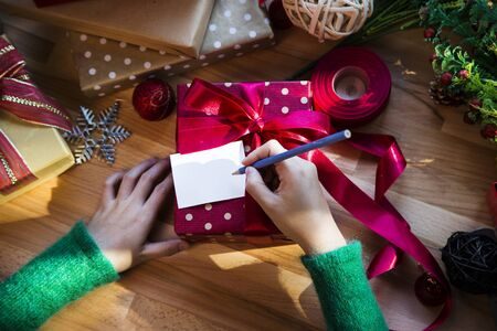 box tree: Overhead shot of Christmas presents and wrapping papers Stock Photo