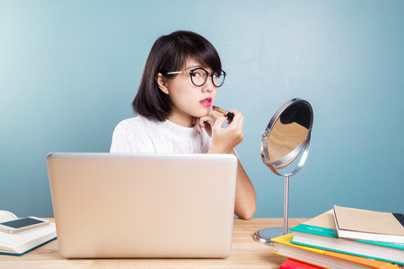 Young asian women make up with workspace table