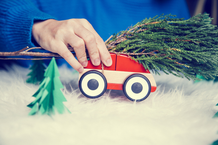 christmas toy: Woman play toy car for christmas. Stock Photo