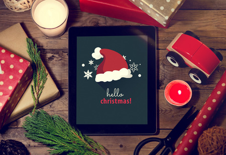 tree decorations: Tablet mock up  with a copyspace for Christmas.Christmas application with Graphic for Christmas.Christmas application Stock Photo