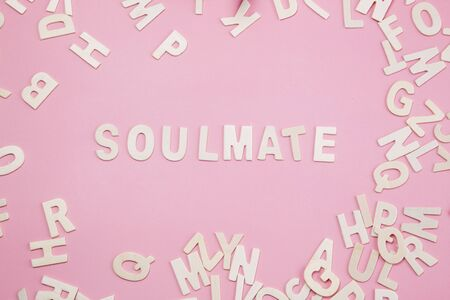 soulmate: Sorting letters Soulmate on pink.