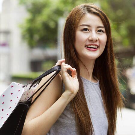 Beautiful asian girls with shopping bags