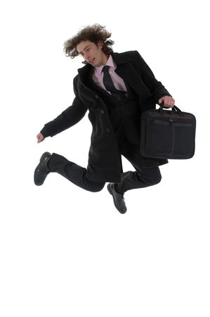 businessman jumping: This photo shows a young businessman jumping .