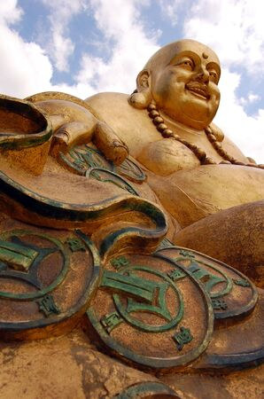 This photo shows a statue of the good luck Buda. photo
