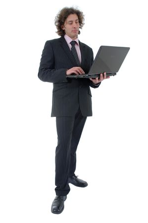 This photo shows a businessman working on laptop .  Stock Photo
