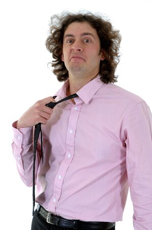 This photo shows a young businessman that is borred by using a tie. Stock Photo