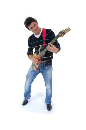 This photo shows a music artist playing is guitar ! !