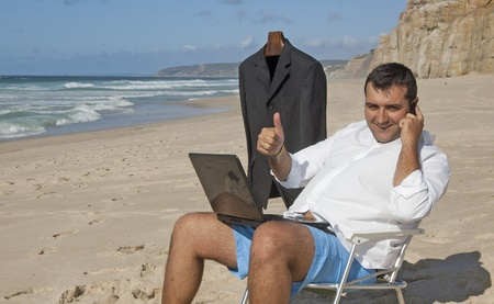 a business man working with a laptop on the beach