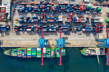 Aerial view of large containers, cranes and lift. Hazira Port, Surat South Gujarat's multi cargo port 免版税图像