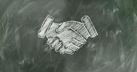 A Image of handshake drawing on the blackboard.