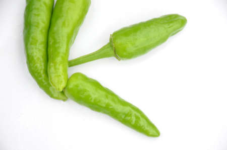 the green ripe chilly isolated on white background.