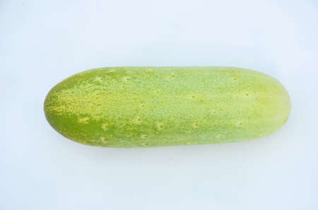 the ripe green cucumber isolated on white background.