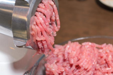 Home meat grinder scrolls minced beef and pork photo