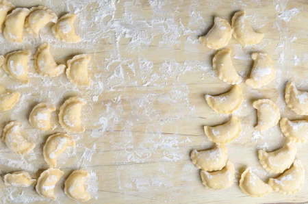 russian food: Making of pierogi with potato (Vareniki. Russian food) .  Rustic style. View from above.