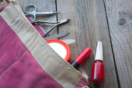 lady's: Pink, ladys bag with a set of cosmetic accessories, red nail polish, scissors, the glass nail file, a small mirror, mascara,